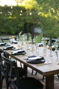 Black and metallic table decor for an under the stars party: Photographer : Carla Choy Read More on SMP: http://www.stylemepretty.com/living/2016/11/11/a-moody-and-glamorous-fall-dinner-party-under-the-stars/