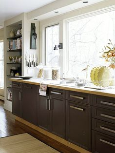 Galley Kitchen - big windows, like the down lamp on the wall and the soffit puck lights, clean cabinets and hardware.