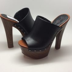 """Jessica Simpson Declan platform sandal Leather Imported Manmade sole Heel measures approximately 5.75"""" Platform measures approximately 2.5"""" Slide-on sandal featuring mule-inspired upper and chunky faux-wood platform Metallic studs at sides Jessica Simpson Shoes Mules & Clogs"""