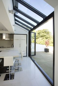 Love open to outside. Glass roof and walls with glazing bars running through in line. Huddersfield Kitchen Extension by Architecture in Glass by AproposUK, House Extension Design, Glass Extension, Rear Extension, Extension Ideas, Kitchen Diner Extension Glass, Bifold Doors Extension, Glass Kitchen, Kitchen Extension Into Garden, Side Return Extension