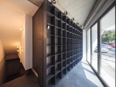 Built by SYAA in Bucharest, Romania with surface Images by Cosmin Dragomir . Wardrobe Shelving, Bucharest, Furniture Making, Stairs, Shelves, Interior Design, Architecture, Gallery, Home Decor