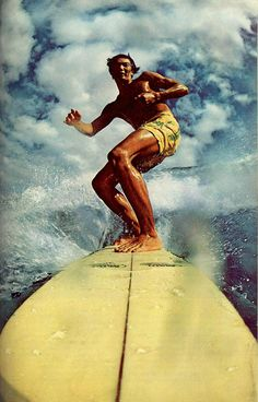"""National Geographic April 1971""""Slicing a path in the sea, a teen-age surfer rides the crest of  a six-footer near Honokowai Point on West Maui."""""""