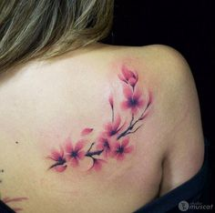 Cherry blossom tattoo on back shoulder by Eiji