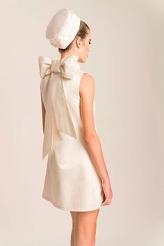Adelais London offer a small collection of vintage inspired bridal fashion for the modern bride. Here we have a 60's Mod mini dress with huge bow at the back of the neck, worn with an oversized pillbox hat at the back of the head. You could easily add a birdcage veil to make it more bridal. Perfect for a small registry wedding. Wear forever as a party dress.
