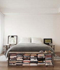 This bench at the end of the bed doubles as a bookshelf and is a great way to bring books into the bedroom.