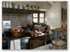 Image Curtesy Art & Decoration Magazine...really like this kitchen, especially all the tins and canisters.