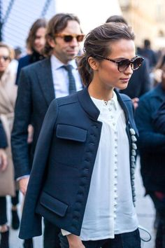 Military jacket, white button up, messy low bun, chic sunglasses