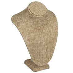 Give your jewelry display a warm natural feel with this elegant burlap necklace bust stand. Each piece is wrapped in burlap to create a natural woven linen look. The necklace bust stand is great for displaying pendants and necklaces. Burlap Necklace Bust - <div style