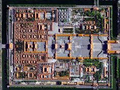 The Forbidden City in Beijing, China was built from 1406 to 1420 by more than one million workers. The palace complex, which contains 9,999 rooms, is surrounded by walls and a moat that are 26 feet high and 171 feet wide, respectively.