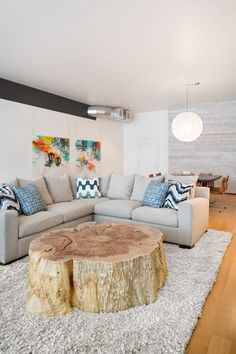 Stump Tables – A big stump would make a wonderful coffee table for the living room. Contemporary sofa, modern decor, oversized tree stump coffee table | modern rustic design