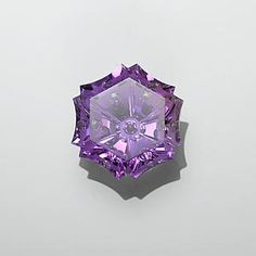 Brazilian Amethyst Incorporating Four Styles Of Gemstone Cutting - Snowflake-cut, Concave-Cut, Negative-Cut And Bubble-Cut With Traditional Flat Faceting