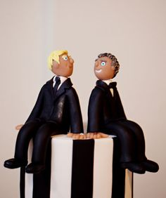 A friend the couple's cake toppers. #newyork #gaywedding
