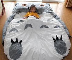 Totoro Sleeping Bag  Spend the day relaxing with a lovable woodland creature the next time you plop down on the Totoro sleeping bag. Styled to look like a giant Totoro this over sized cushion makes the ideal spot for a reading nook or taking a light nap.  $299.00  Check It Out  Awesome Sht You Can Buy