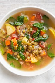 This hearty lentil soup gets its bright flavor from fresh tomatoes and wilted spinach. A colorful array of chopped celery, onion, carrots, . Lentil Recipes, Vegetarian Recipes, Healthy Recipes, Bean Soup Recipes, Diet Soup Recipes, Gnocchi Recipes, Yummy Recipes, Whole Food Recipes, Cooking Recipes