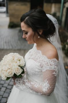 Bride wearing Legends Romona Keveza gown and lace jacket, Ivy and Aster sash, and Christos Bridal veil, all from Something White, A Bridal Boutique, Independence, Ohio | photo by The Carrs Photography