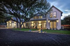 This stunning modern farmhouse style home was designed by Tim Brown Architecture, located in a neighborhood outside of the heart of Austin, Texas.