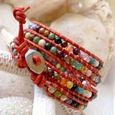 This is a womens, bohemian style 5 wrap, leather and glass beaded bracelet. Love all the variety of colors in this bracelet. This is handmade