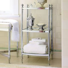 Elevate the presentation of towels and grooming products atop shelves of beveled, tempered glass with our exclusive Belmont Etagere. A sturdy, precision-tuned steel frame with fluted aluminum tubes and shapely finials adds beauty to the bath.  Frame is made of steel with aluminum tubes Zinc alloy feet            Enhances your bathroom d while keeping essentials within reach                   Size options are tailored to your needs                   Part of our signature Belmont collectio...