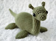 Crochet yourself a soft and cuddly Loch Ness monster! I am pleased to offer this design free of charge to anyone who wants to make their own Nessie, but please note that this pattern has not been tested or tech edited. It is intended for crocheters who already have some experience making amigurumi. If you have any questions, suggestions, or corrections, please send me a message!