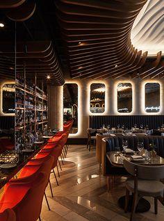 Nulty - Haz Restaurant, Planation Place, London - Lighting Scheme Dining Bar Mirrors Halo Glow Ceiling Wooden Slats Downlights
