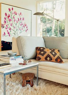 Global elements like this kuba pillow add cultural style to a modern room.