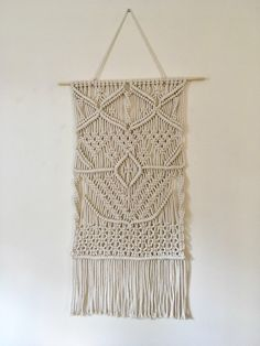 A personal favourite from my Etsy shop https://www.etsy.com/uk/listing/493487506/large-macrame-wall-hanging