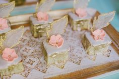 Mini desserts don't always have to be super elaborate to be gorgeous. These mini desserts are simply sliced but topped with the most amazing sugar flowers. The Frosted Petticoat