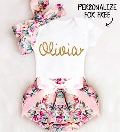 """SWEETEST BABY OUTFIT EVER. How pretty will her little name look in this GORGEOUS gold writing?! This adorable outfit is ALWAYS the favorite at every baby shower! Perfect for a Coming Home Outfit, Newborn photo shoot, Baby Shower Gift or the perfect pretty look for a very special baby girl. *WRITE HER NAME in the """"NOTES TO SELLER"""" SECTION AT CHECKOUT* Her name will be customized in the design and font shown above, just like the sample picture. See other Newborn Outfits: https://www..."""