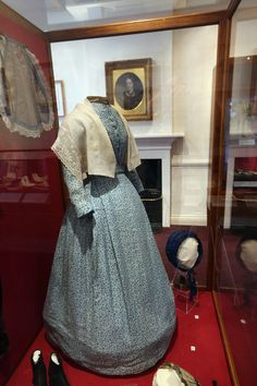 Clothes and accessories worn by Charlotte Bronte on display in her old bedroom at the Bronte Parsonage Museum in Haworth, England
