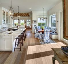Kitchen ideas. Pendant lamps. Island. Counter stools. Open floor plan. Breakfast room. Fancy - Cape Cod Collegiate