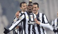 Juventus\' Paul Pogba celebrates with his team mates Leonardo Bonucci (R) and Mirko Vucinic after scoring against Udinese during their Italian Serie A soccer match at the Juventus stadium in Turin