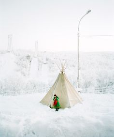 """Sami girl in front of Lavoo – 2006, Russia, Moermansk. They used to be called the """"Laplanders."""" But their name is Sami and they're the """"People of the Reindeer."""" Russia, Iceland and Scandinavian countries."""