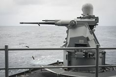 A MK-38 25mm machine gun system fires rounds during a training exercise on the fantail of USS Nimitz (CVN 68).