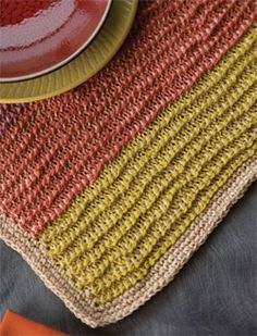 Summer's Day Placemats by Kim Guzman  Tunisian crochet instructions include one placemat worked lengthwise and the other widthwise for a little diversity.