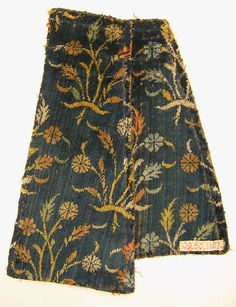 Velvet Fragment with Floral Pattern Object Name: Fragment Date: 16th century Geography: Iran Culture: Islamic Medium: Silk; cut velvet Dimensions: Textile: H. 8 1/2 in. (21.6 cm) W. 7 7/8 in. (20 cm) Mount: H. 12 in. (30.5 cm) W. 8 1/2 in. (21.6 cm) D. 1 7/8 in. (4.8 cm) Classification: Textiles Credit Line: Rogers Fund, 1909 Accession Number: 09.50.1107a, b