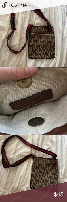 Michael Kors Crossbody Bag Michael Kors crossbody bag with adjustable strap. Three pockets make it perfect for any day trip! MICHAEL Michael Kors Bags Crossbody Bags