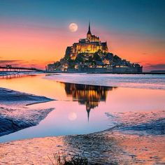 "lsleofskye: ""Fairy Tale "" Mont Saint-Michel, France, at high tide. Photo by İlhan Eroglu. Mont Saint Michel France, Le Mont St Michel, Beautiful Castles, Beautiful World, Beautiful Places, Amazing Places, Places To Travel, Places To See, Landscape Photography"