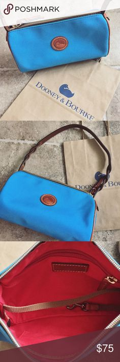 Dooney & Bourke Small Barrel Small Authentic Dooney & Bourke barrel bag. Turquoise color, and brown leather accent trims. This bag was only worn once and in extremely great condition. Dimensions are: 8.5 in. X 5in. X 3in. Dooney & Bourke shopping bag not included. Dooney & Bourke Bags Mini Bags