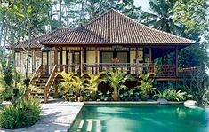 Inspired by a cottage on Banda Neira in Indonesias Moluccas the bungalow sits on the sites highest elevation. We left. Tropical Architecture, Residential Architecture, Architecture Design, Thai House, Architectural Digest, Ubud, Bungalow, Balinese Villa, Jungle House