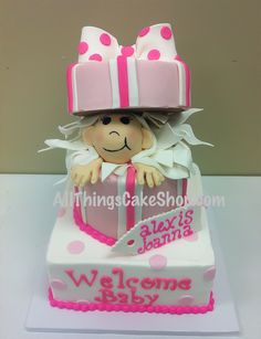 Peek-a-boo! Baby in a box baby shower cake complete with edible, fondant bow, tissue paper, tag, etc.