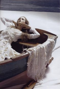 """Elaine of Astolat, also known as the Lady of Shalott, is a figure in Arthurian legend who dies of her unrequited love for Lancelot. Elaine's story is also the inspiration for Tennyson's poem """"The Lady of Shalott""""."""
