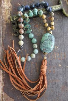 Gorgeous earthy mix of semi precious stones and Czech glass beads hand knotted with super soft leather tassel. Artisan bronze and sterling accents.  Measures 17 1/2 long with an additional 9 1/2 stone and tassel drop. Sterling closure.  As with all of my jewelry, I ONLY use TOP quality materials in my work. The result is well worth it and it shows! ORIGINAL LIST DATE: June 30, 2016* Often imitated, never duplicated!-- You see it here first :)