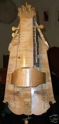 Chris Allan Hurdy Gurdy, and medieval instrument you crank.  It almost sounds like bagpipes and violins playing together