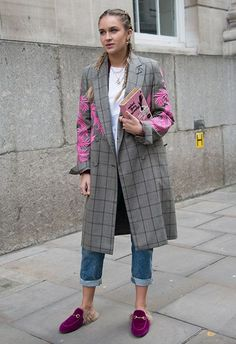 Blogger Nina Suess at London Fashion Week wearing Gucci mule loafers, oversized blazer, jeans and a white T-shirt | ASOS Fashion and Beauty Feed