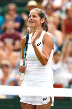 Julia Goerges of Germany celebrates winning match point against Donna Vekic of Croatia during their Ladies' Singles fourth round match on day seven of the Wimbledon Lawn Tennis Championships at All England Lawn Tennis and Croquet Club on July 9, 2018 in London, England.