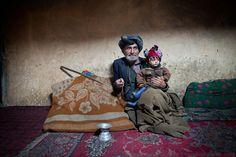 An old Wakhi Man and his grandson. Photographer: Matthieu Paley
