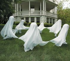 Creepy Staked Yard Ghosts--cute but I don't want to pay that much for them. Surely I (or someone) can figure out how to DIY?