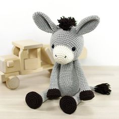 This crochet pattern includes all the instructions needed to make this cute donkey, illustrated with many step-by-step photos. Arms and legs are attached using doll joints (or buttons and yarn) to make them movable.  Includes one PDF file, 17 pages. Pattern is written in English, using