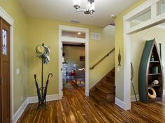 With bamboo flooring and craftsman-style doorways, the foyer establishes the home's warm, welcoming and open design approach.