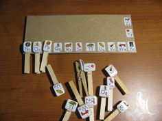 Fine Motor / visual-perceptual / bilateral coordination task with identical matching. Students match identical letters/pictures by clipping clothespins.  Made with cardboard, letter stickers, spring loaded clothespins. I put the stickers on hard plastic and then used sticky velcro to attach them to the clothespins. I also tried hot glue, but they kept coming off